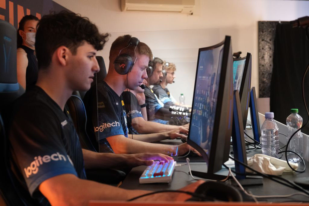 Five esports players competing at a big event.
